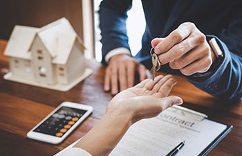 real estate agent handing in house keys