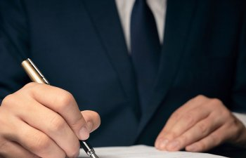 an attorney signing documents